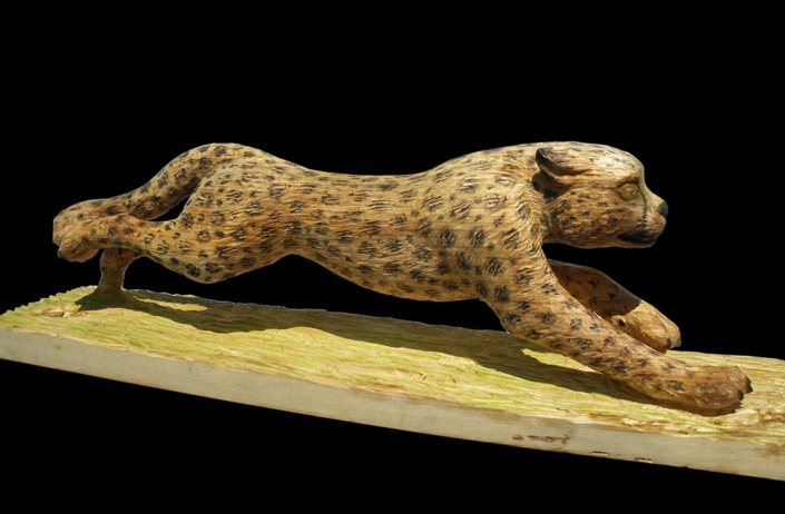 Gepard im Sprint, 2012 Pappelholz/Acrylfarbe, Länge ca. 1,10m X 30cm